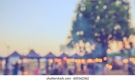 abstract blur image of day festival for background usage . (vintage tone)