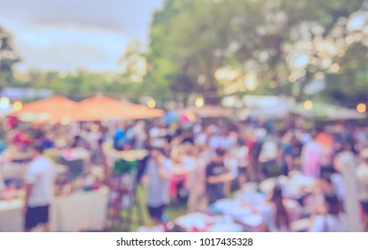 Abstract blur image of  Day Market in garden with bokeh for background usage . (vintage tone)