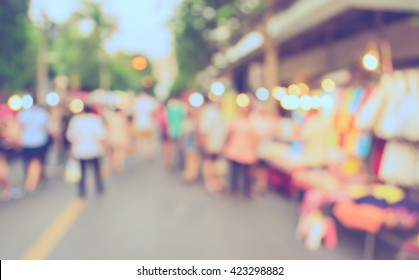 Abstract blur image of day market on street for background usage. (vintage tone)