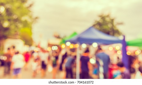 Abstract blur image of Day market on street with bokeh for background usage . (vintage tone)