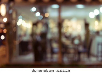abstract blur image decoration interior restaurant with light glittering in the night