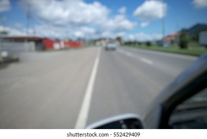 abstract blur image of drive a car on sunny day