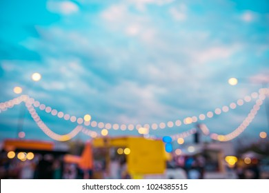 abstract blur image of food stall and food truck at day festival for background usage. (vintage tone)