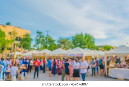 abstract blur image of food stall at day festival for background usage.