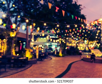 abstract blur image of food stall at night market festival for background usage . (vintage tone) - Shutterstock ID 521709037