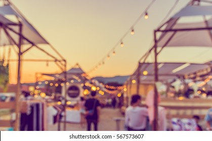 abstract blur image of food stall at day festival for background usage. (vintage tone)
