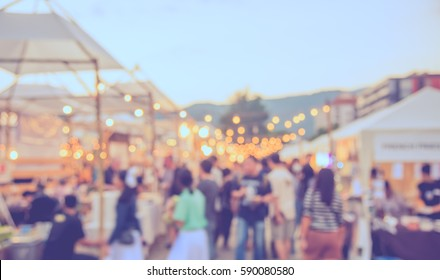 abstract blur image of food stall at day festival for background usage . (vintage tone) - Shutterstock ID 590080580