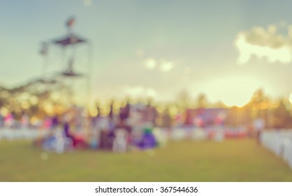 abstract blur image of group of stage staff in day festival for background usage