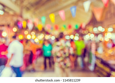 Abstract blur image of  Indoor day market with bokeh for background usage . (vintage tone)