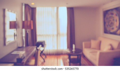Abstract blur image of living room for background usage . (vintage tone)