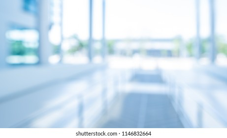 Abstract blur image of  Long corridor with bokeh for background usage .