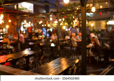 abstract blur image of night festival in a restaurant and The atmosphere is happy and relaxing with bokeh for background, Bangkok Thailand.