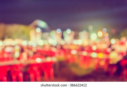 Abstract blur image of night festival on street with bokeh.