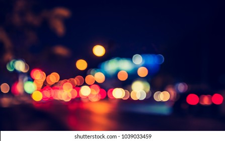 Abstract blur image of Night  light bokeh on street for background usage. (vintage tone)