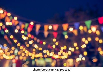 abstract blur image of night market festival for background usage . (vintage tone)
