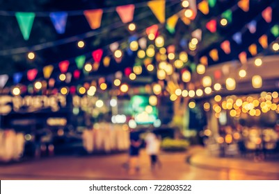 abstract blur image of night market festival with bokeh for background usage . (vintage tone)