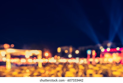 abstract blur image of outdoor concert  at night festival for background usage . (vintage tone)