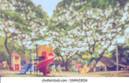 Abstract blur image of  Outdoor Playground in garden with  bokeh for background usage. (vintage tone)