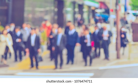 Abstract blur image of People crossing at street in city (vintage tone)