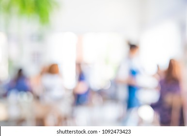 Abstract blur image of People at Restaurant or Cafe on day time with bokeh for background usage .
