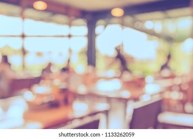 Abstract blur image of People at Restaurant or Cafe on day time with bokeh for background usage . (vintage tone)
