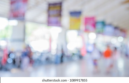Abstract blur image of People walking at Shopping mall or Exhibition hall with bokeh for background usage .