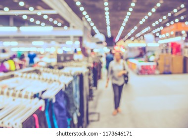 Abstract blur image of People walking at shopping mall with bokeh for background usage . (vintage tone)