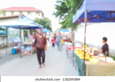 Abstract blur image of people walking at street market, use for background. (Vintage tone)