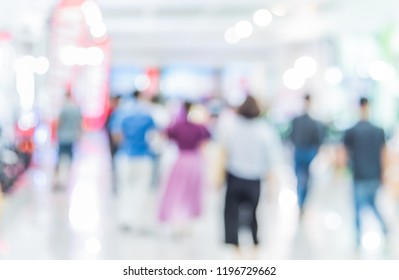 Abstract blur image of People walking at shopping mall with bokeh for background usage