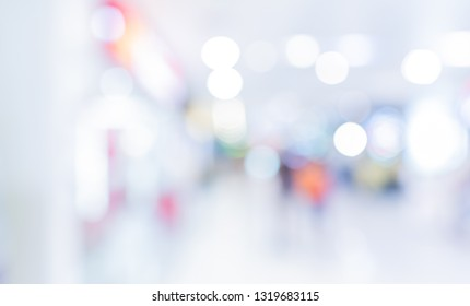 Abstract blur image of  People walking at shopping mall with bokeh for background usage .