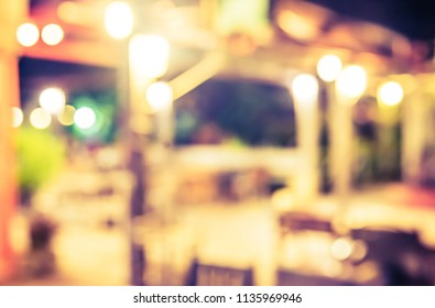 Abstract blur image of  Restaurant or Cafe in night time with bokeh for background usage . (vintage tone)