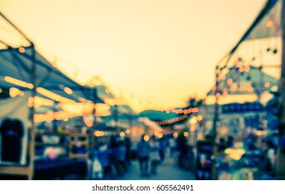 abstract blur image of retail shop at day festival for background usage . (vintage tone)