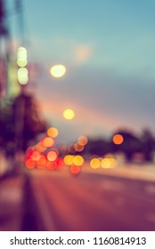 Abstract blur image of Road in evening time  with light bokeh for background usage . (vintage tone)