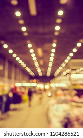 Abstract blur image of shop in large hall for background usage.