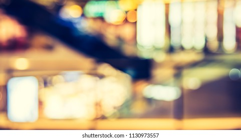 Abstract blur image of  shopping mall with bokeh for background usage . (vintage tone)