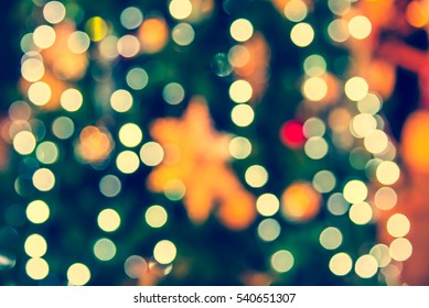 abstract blur image of shopping mall  on christmas time for background . (vintage tone)