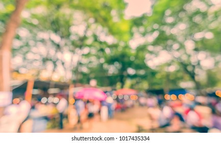 Abstract blur image of Street Day Market with bokeh for background usage . (vintage tone)