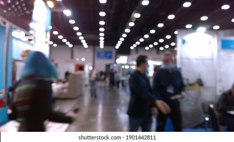 Abstract blur image of trade show expo background. Modern business venue. New Conference, convention and exhibition centre. Financial and economic growth and crisis concept. Collaborative space.