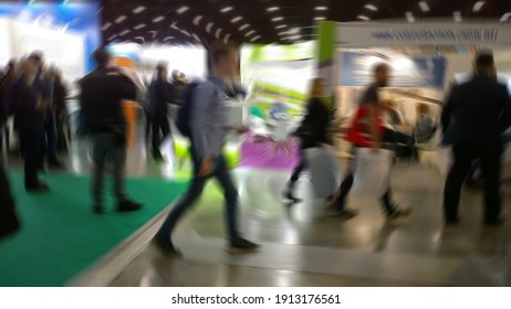 Abstract blur image of trade show expo background. Business venue. Conference, convention and exhibition centre. Financial and economic growth and crisis concept. Collaborative space. People motion.