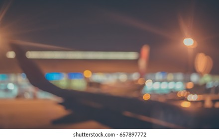 Abstract blur image of  veiw from plane to see airport in night time with bokeh for background usage . (vintage tone)