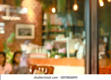 abstract blur of interior inside coffee cafe shop background with light effect for design element. Blurred cafe background with bokeh. orange ,red, light.