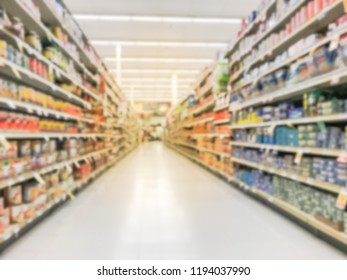 Abstract blur low angle aisle of canned meals and bean at supermarket. Wide selection of pickles, olives, canned meats, condiments, pasta sauce, salad dressing and preserving vegetable, meats, poultry