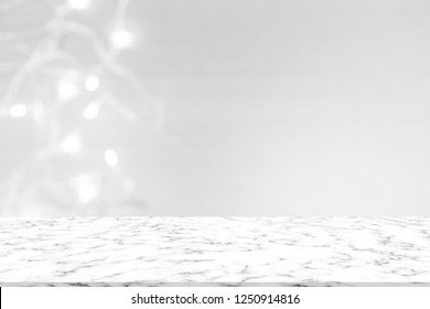 abstract blur luxury blue bokeh light with glitter shine wallpaper and white marble counter table top background texture for promote and show or advertise product on display