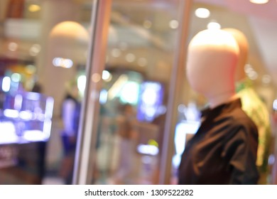 abstract blur luxury business shopping mall with mannequin model dummy stand showing fashion clothes in retail front store interior background