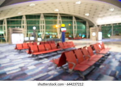 Abstract blur modern empty departure lounge at the airport terminal gate background