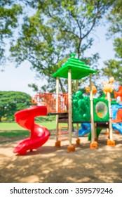 Abstract blur outdoor children playground in Bangkok city park background