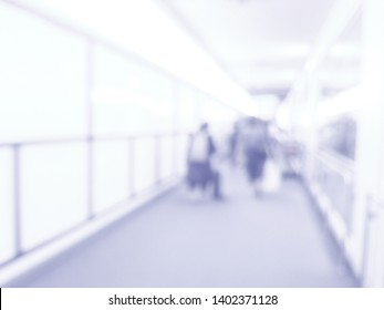 Abstract blur passenger in terminal with lighting bokeh,well use montage text present for on free space background