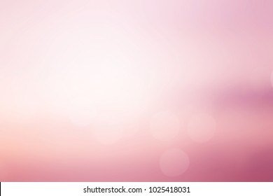 abstract blur of pastel beautiful sunrise pink color sky warm tone background with shining light flare and bokeh for design as banner,slide show or others