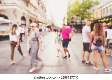 abstract blur people background, silhouettes of unrecognizable people walking on a street