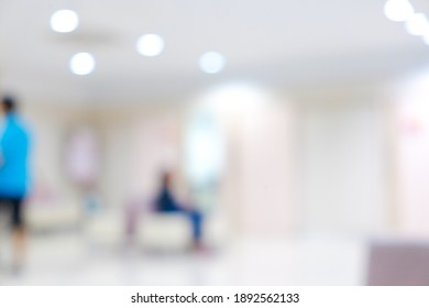Abstract blur people in beautiful luxury hospital and clinic interior with bokeh